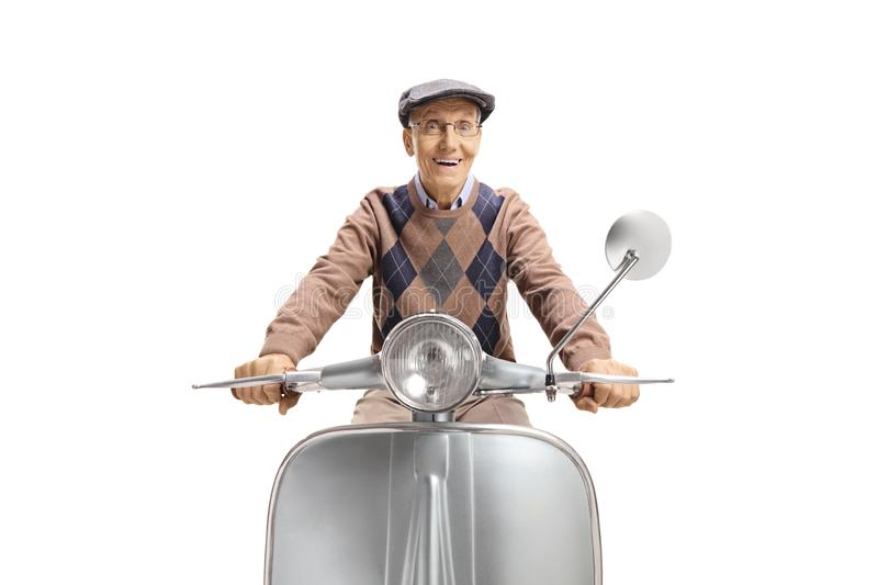 Excited elderly man riding a vintage moped royalty free stock photos