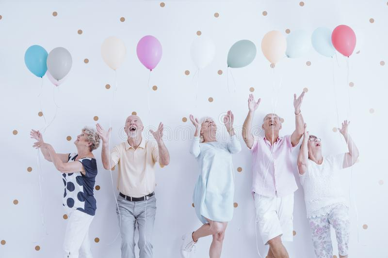 Excited elderly men and women stock images
