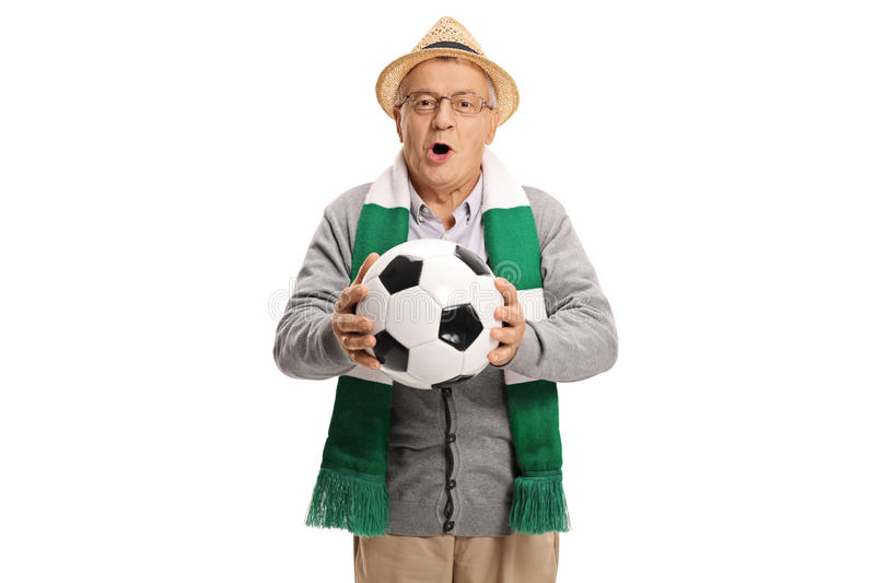 Excited elderly soccer fan with scarf and football cheering stock image