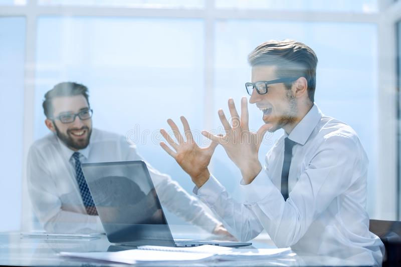 Excited employees enjoying the good news on the Internet royalty free stock image