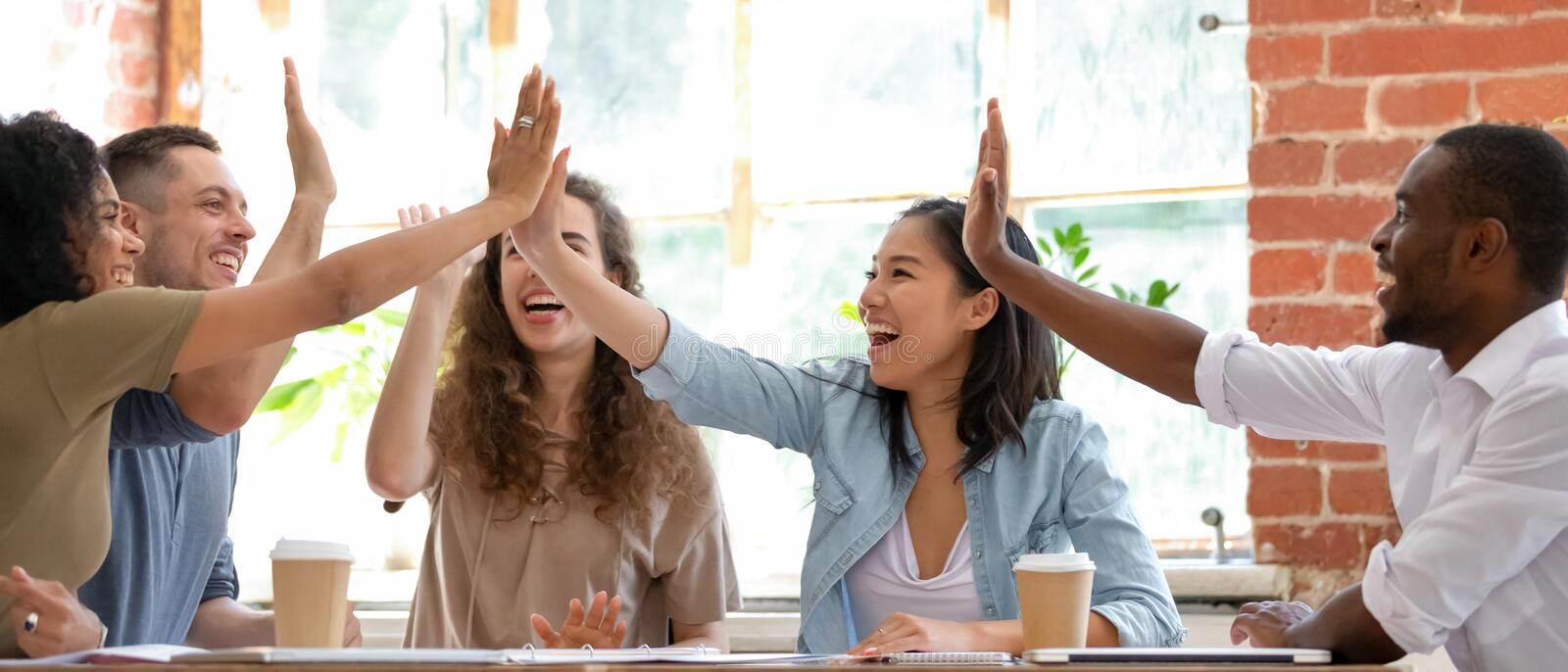 Excited employees or students feels happy giving high five stock images