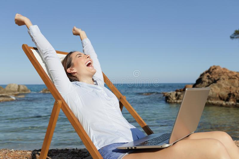 Excited entrepreneur with laptop celebrating success stock images