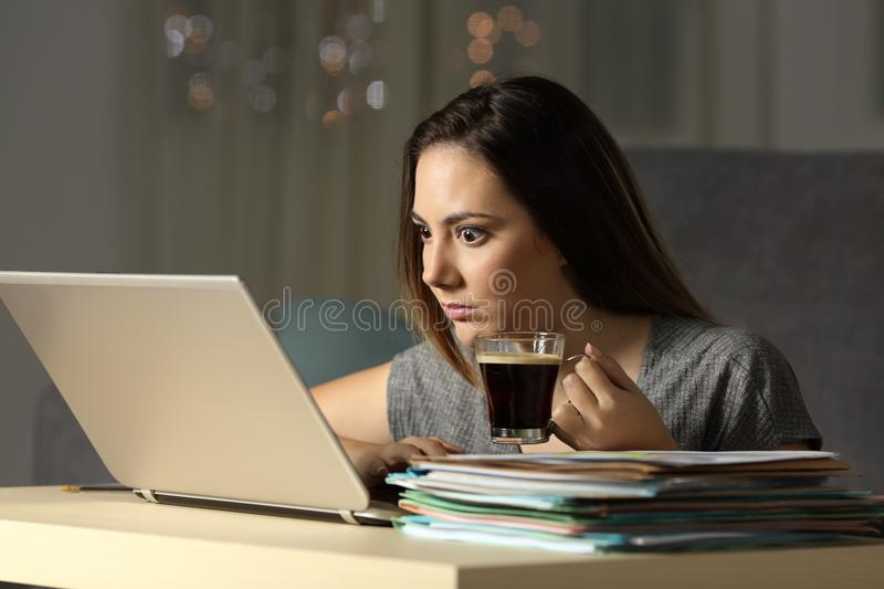 Excited entrepreneur working hard late hours royalty free stock photography