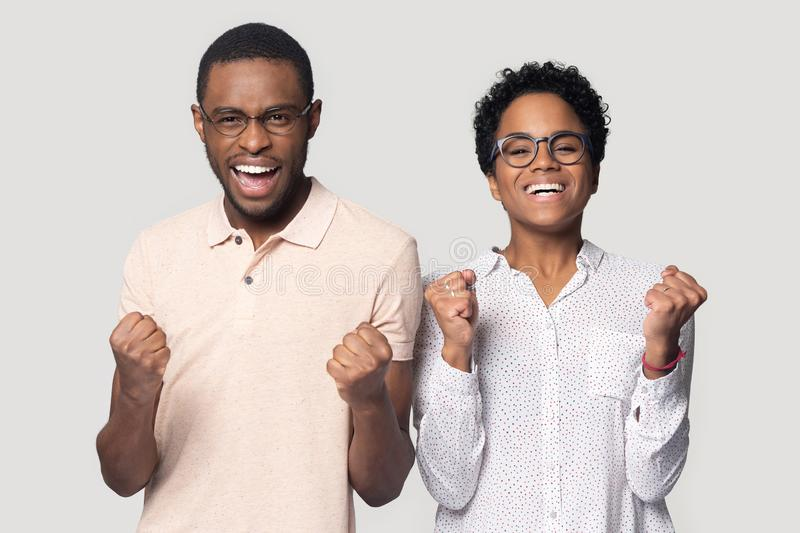 Excited ethnic couple wearing glasses feel overjoyed with news stock photo