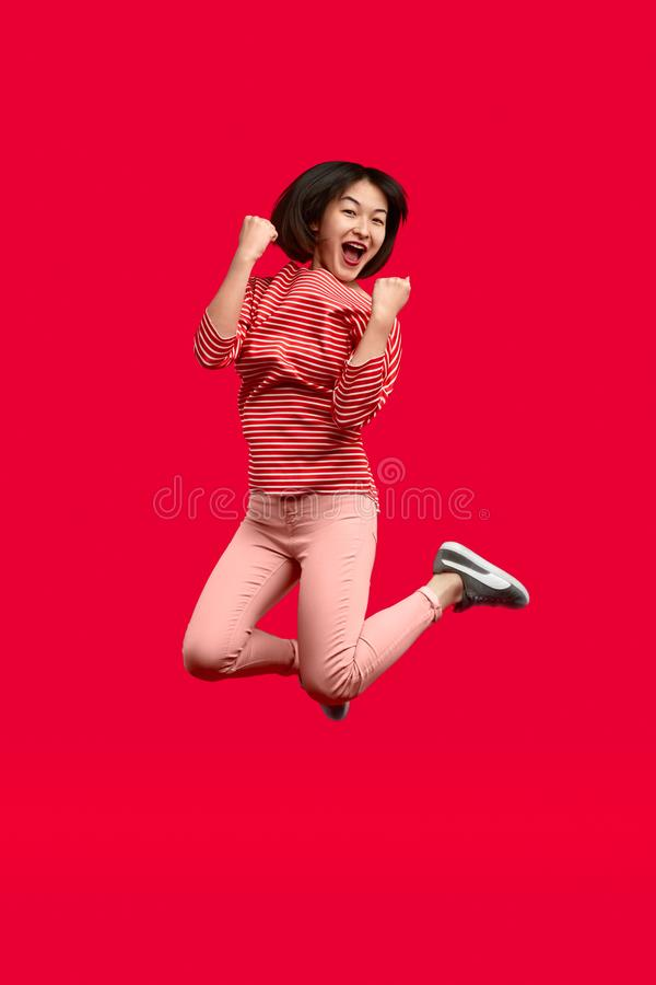 Excited ethnic woman jumping and celebrating victory royalty free stock photos
