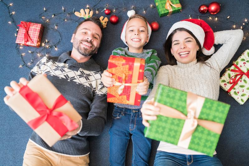 Excited Family With Christmas Gifts At Home royalty free stock images
