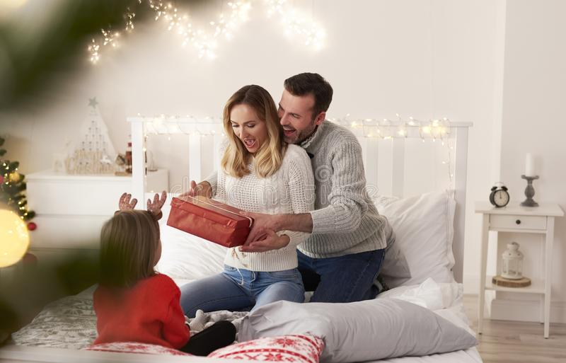 Excited family with gift spending Christmas morning together royalty free stock photo