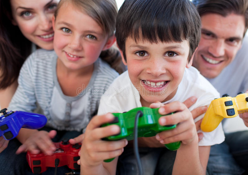 Excited Family playing video games stock photography