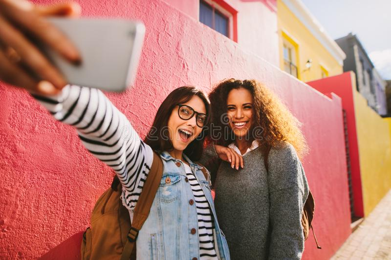 Excited female travelers taking selfie royalty free stock photos