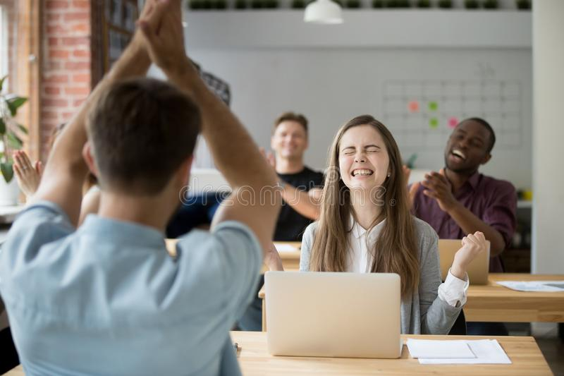 Excited female worker happy with online win royalty free stock photos