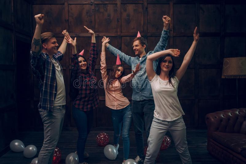 Group of friends dance at birthday party royalty free stock photos