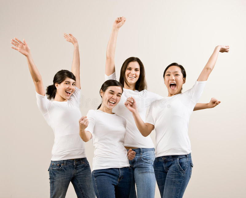 Excited friends cheering royalty free stock photo