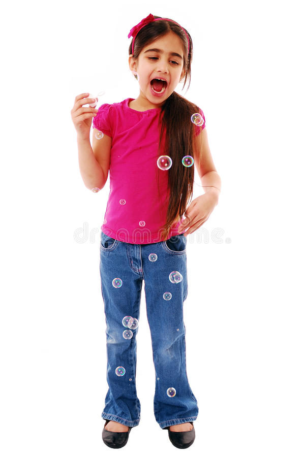 Excited girl blowing bubbles. Adorable little girl blowing bubbles isolated on white stock photography