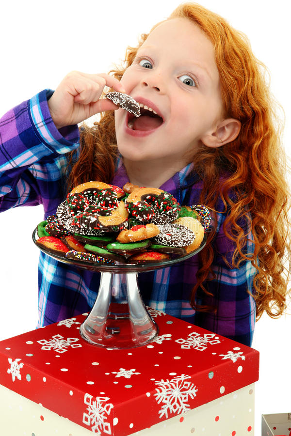 Excited Girl Child in Pajamas with Tray of Cookies royalty free stock image