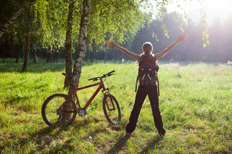 Download Excited Girl Cyclist Standing In Sunny Park Stock Photo - Image: 28815672
