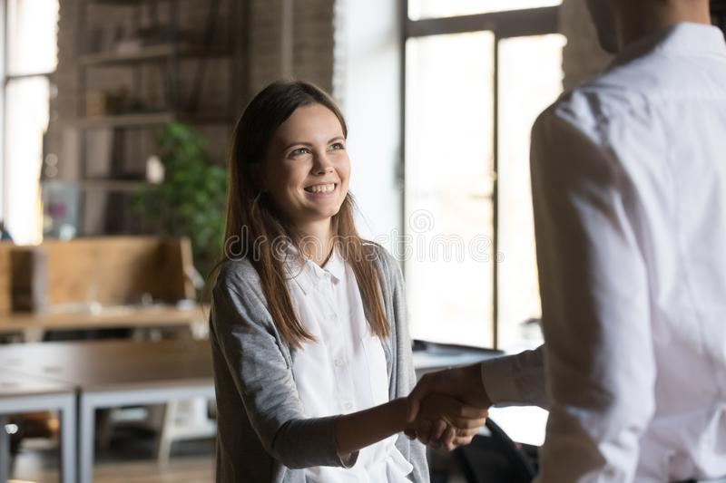 Excited girl intern handshaking executive manager getting hired stock photos