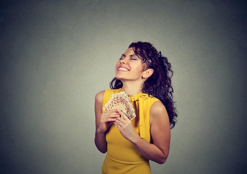 Excited girl with pile of money royalty free stock photography