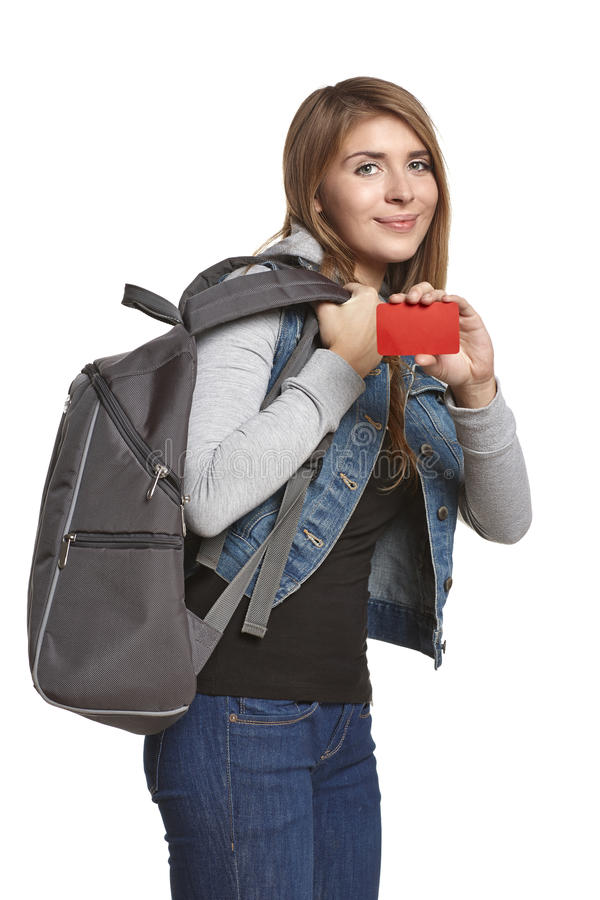Happy girl with backpack showing blank credit card stock image