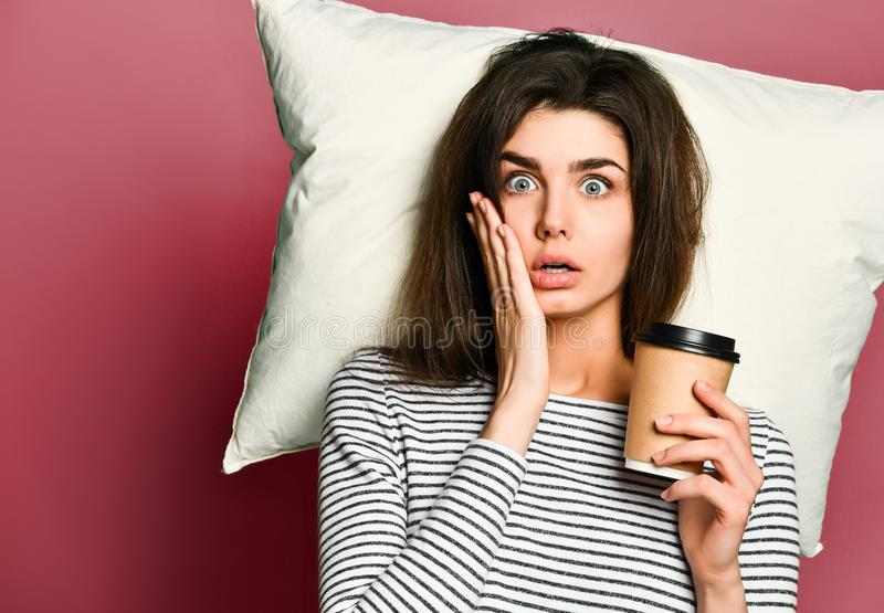 Excited girl woman drinks coffee at home or in the office, suddenly realizes that she is very late for work, stock images