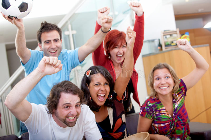 Download Excited Group Watching Football Stock Photo - Image of concentrated, smile: 12310740