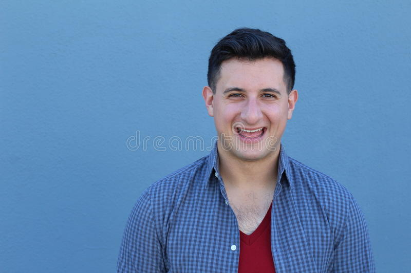 Excited guy against blue background - Stock image.  stock image