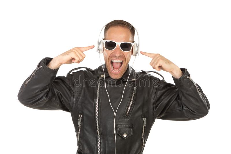 Excited guy listening music royalty free stock images