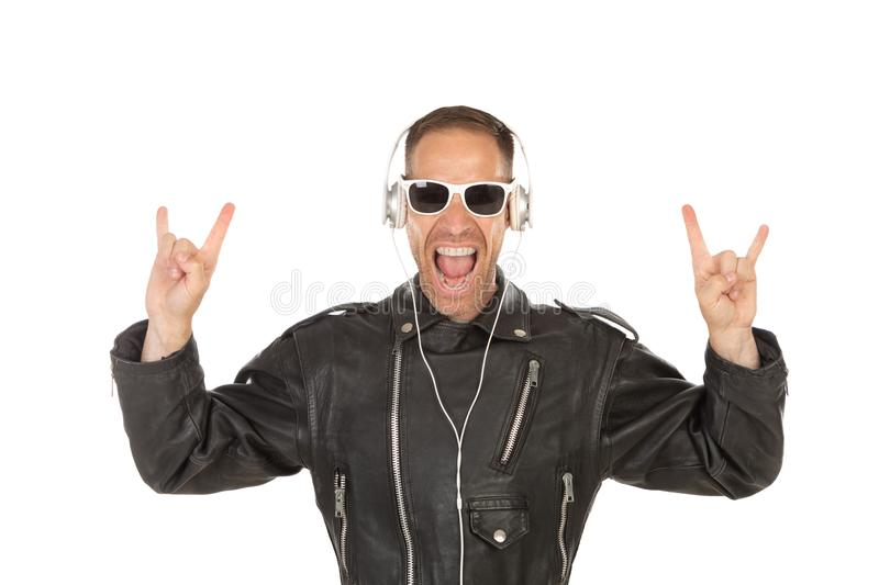 Excited guy listening music stock images