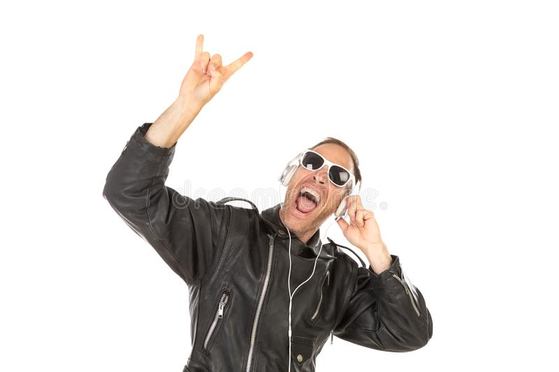 Excited guy listening music stock photos