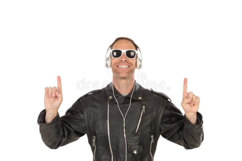 Excited guy listening music royalty free stock photos