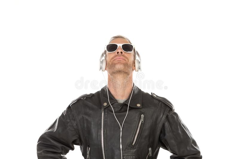 Excited guy listening music royalty free stock image