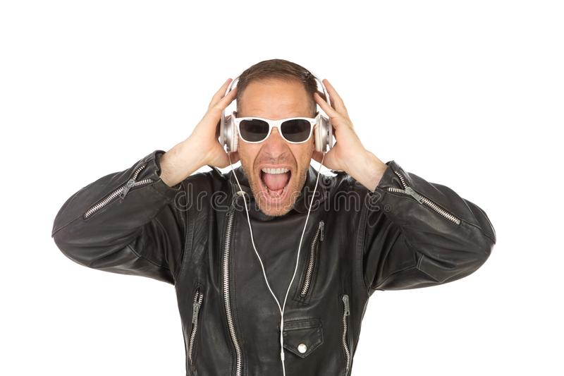 Excited guy listening music royalty free stock photography