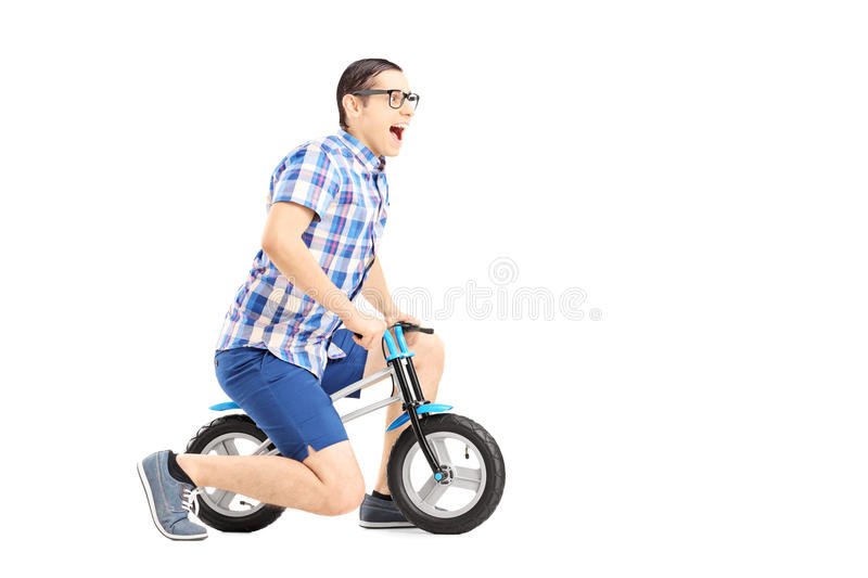 Download Excited Guy Riding A Small Bicycle Stock Photo - Image: 35555168