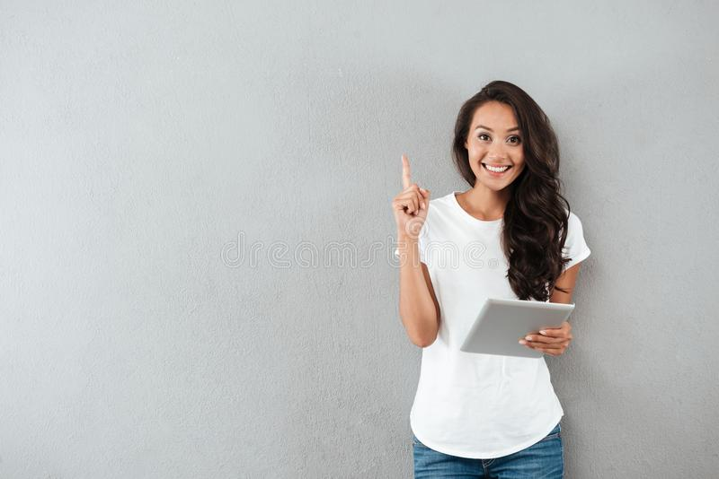 Excited happy asian woman holding tablet computer royalty free stock photography
