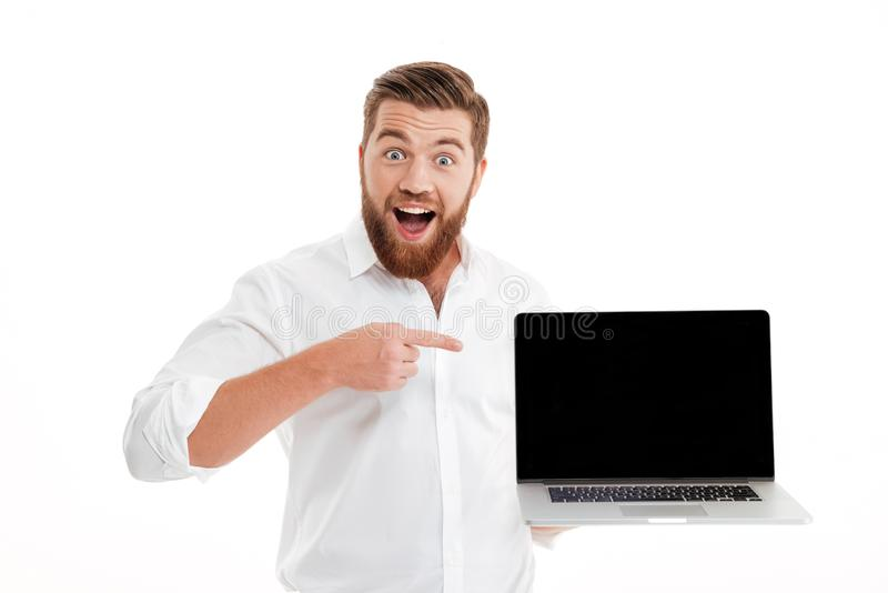 Excited happy bearded man pointing finger stock photography
