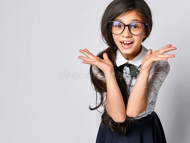 Excited happy confused girl school girl in white blouse and glasses. royalty free stock images