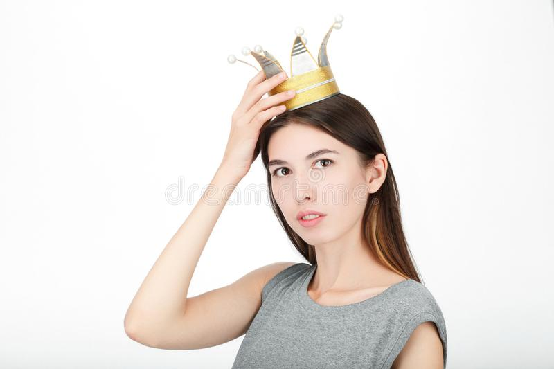 Excited happy looking woman wearing a handmade princess crown. Closeup of happy mixed race asian caucasian female model isolated o stock image