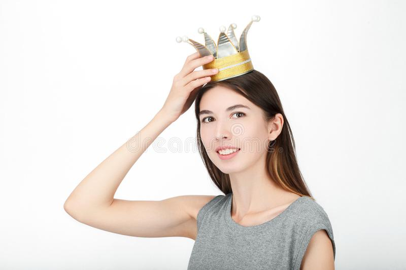 Excited happy looking woman wearing a handmade princess crown. Closeup of happy mixed race asian caucasian female model isolated o stock photo