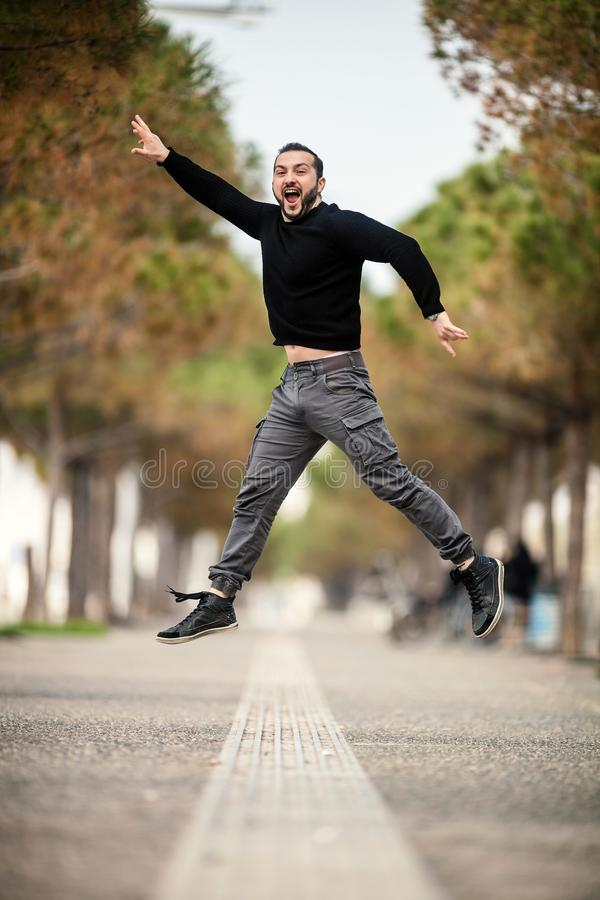 Excited Happy Man Jumping Up, Wearing Casual Clothes royalty free stock photos