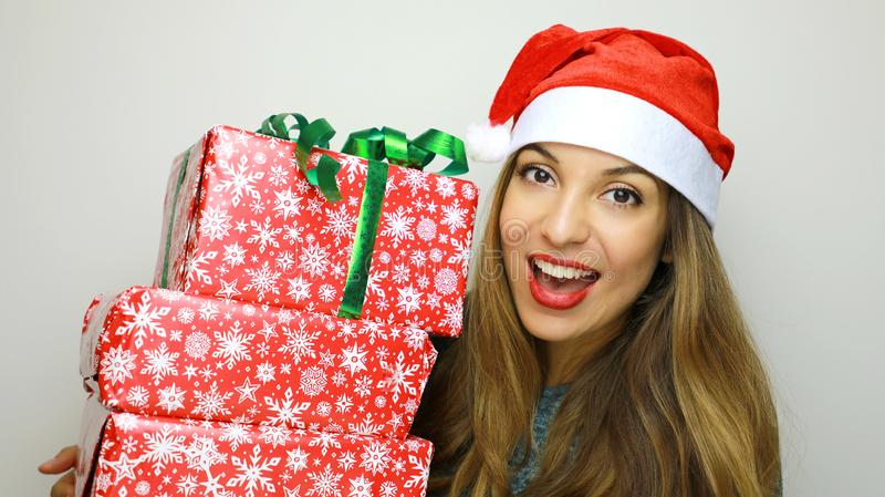 Excited happy woman in red santa claus hat holding stack present royalty free stock photos