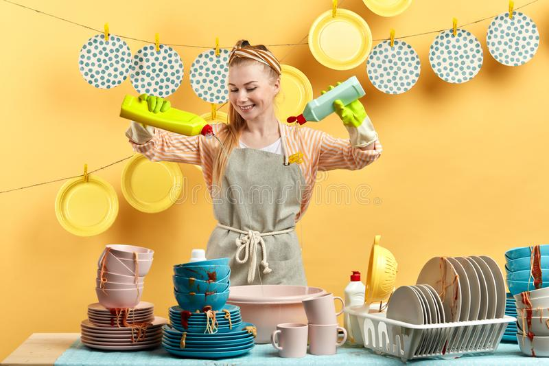 Excited happy young blonde woman doing housework royalty free stock photo