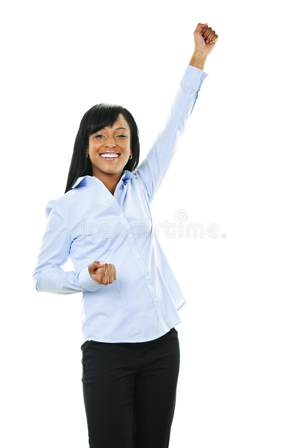Excited happy young woman with arm raised stock images