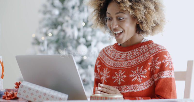 Excited happy young woman at Christmas stock image