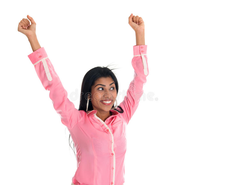 Excited Indian business woman arms up cheering stock photos