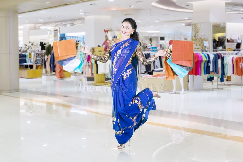 Excited Indian woman carrying shopping bags stock images