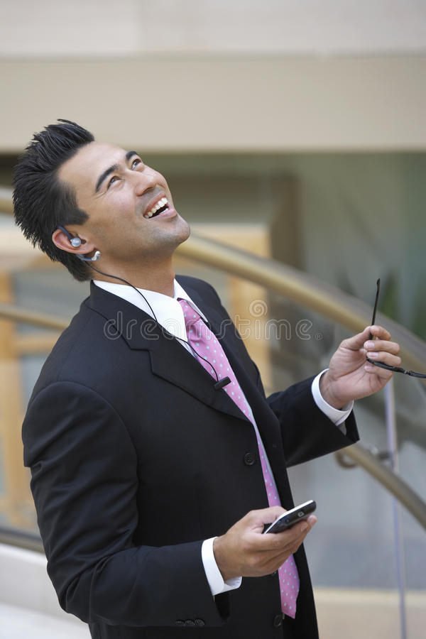 Excited Japanese Businessman Looking Up stock photo