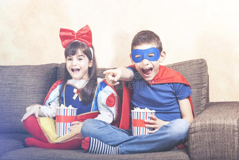Kids watching TV stock photography