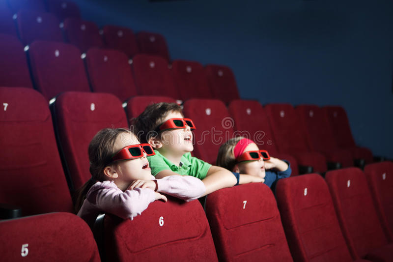 Excited Kids Watching Cartoon Royalty Free Stock Image