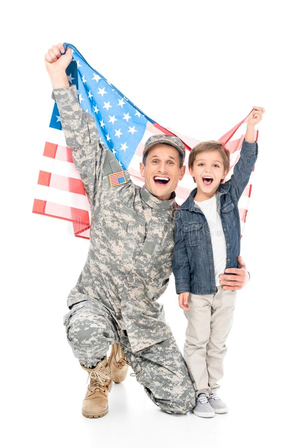 excited little boy and father in military uniform holding american flag together stock photos
