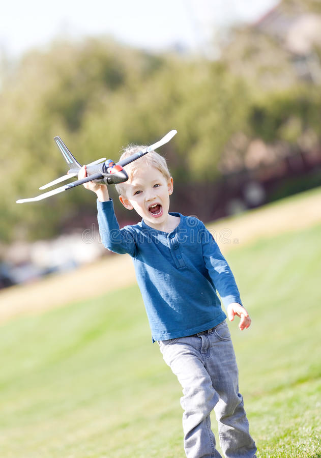 Download Child Playing With A Plane Royalty Free Stock Photo - Image: 29832785
