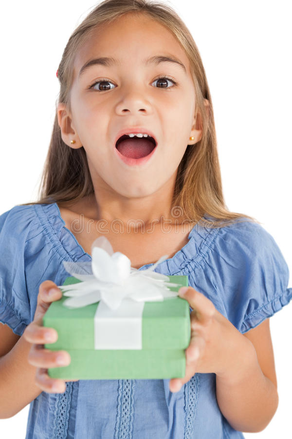 Download Excited Little Girl Holding A Wrapped Gift Stock Photography - Image: 33053562